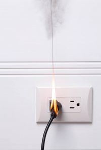 Burning cord in electrical outlet